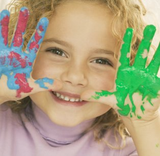 Picture of child with paint on hands
