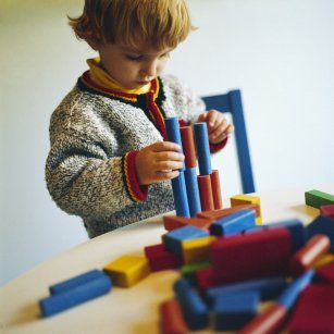 Picture of child playing with wood blocks